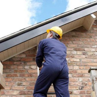 An inspector inspecting the roof of a home