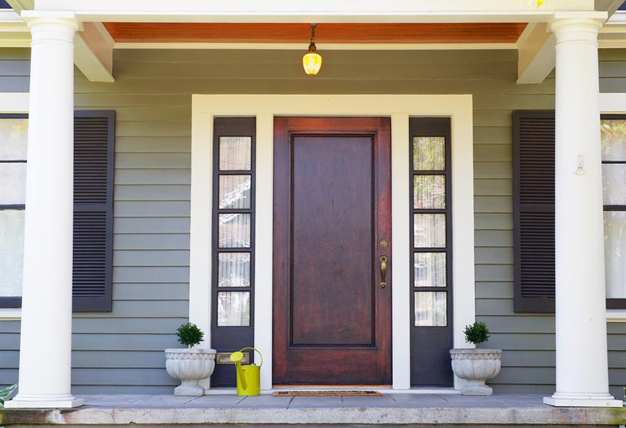Large brown door to a home