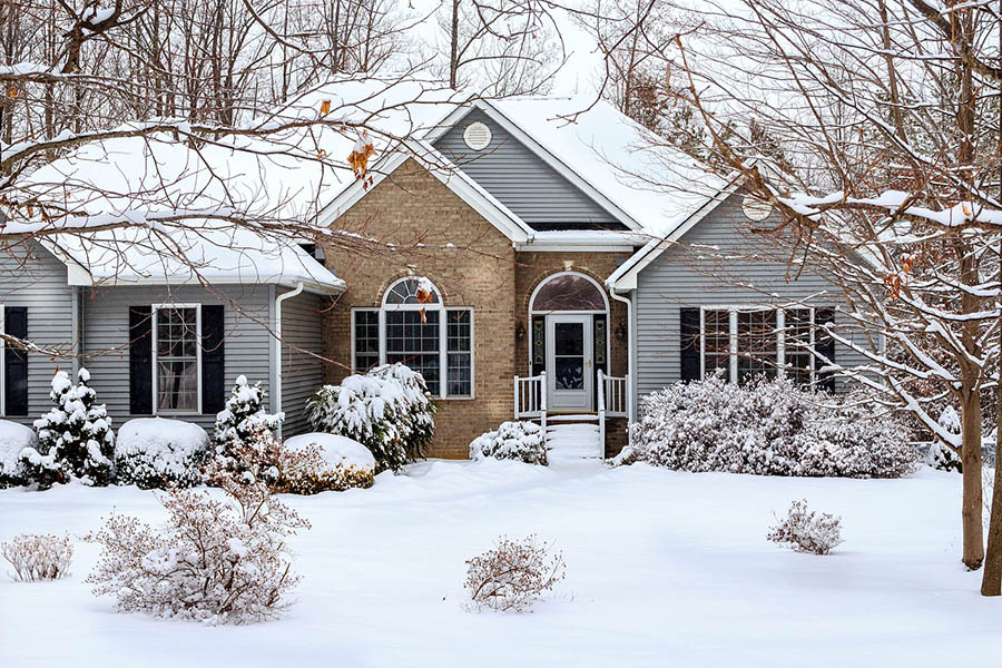 Large detached home after a snowfall