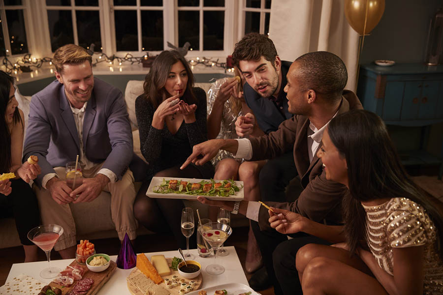 Group of friends talking at a holiday party