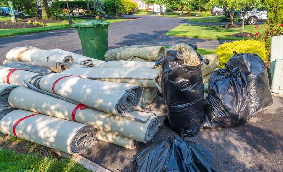 Pile of rugs and garbage from a sewer backup