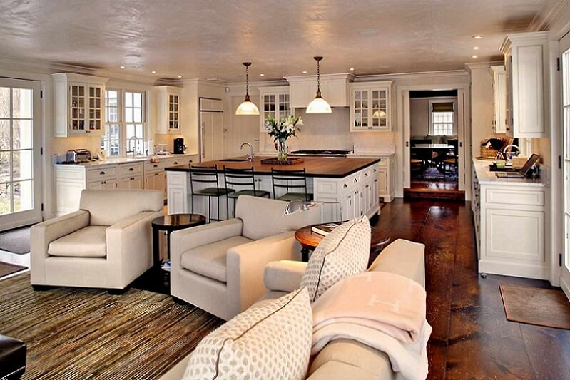 Open concept kitchen and living room with hardwood floors