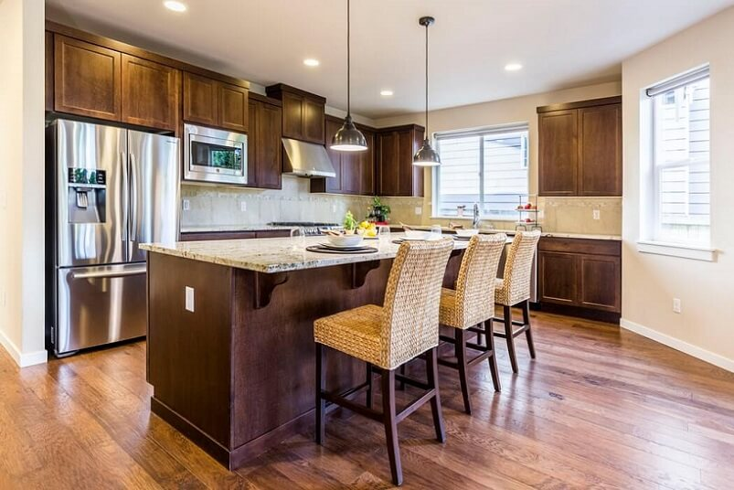 Warm kitchen with island and hardwood floors
