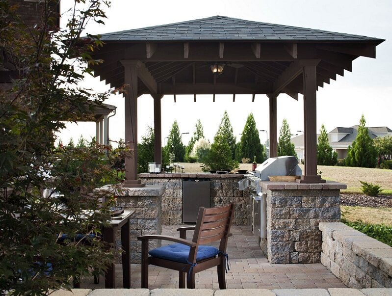 Outdoor kitchen with a gazebos and seating area