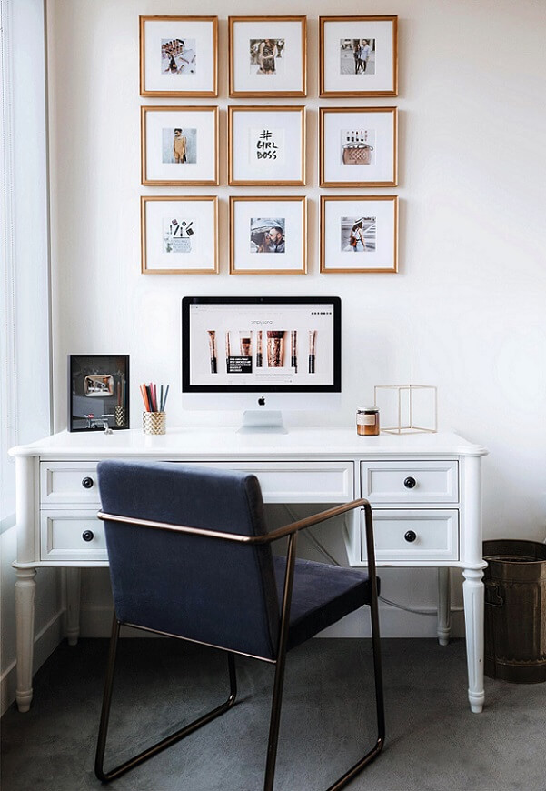 Tall gallery wall display above a home office desk