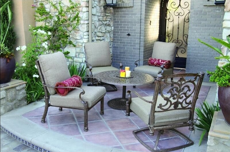 Stone and tile outdoor patio with aluminum chairs and table