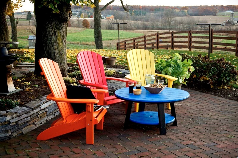 Plastic outdoor furniture on a brick patio
