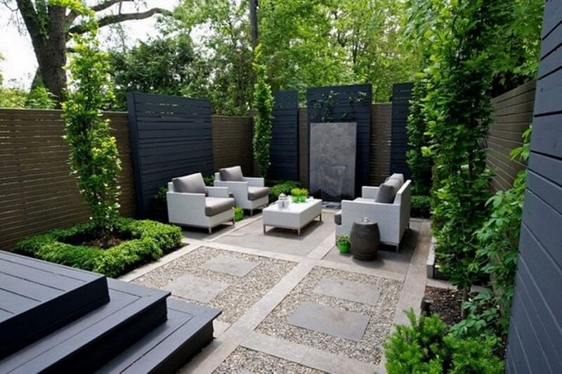 Empty patio space with modern furniture and stone work