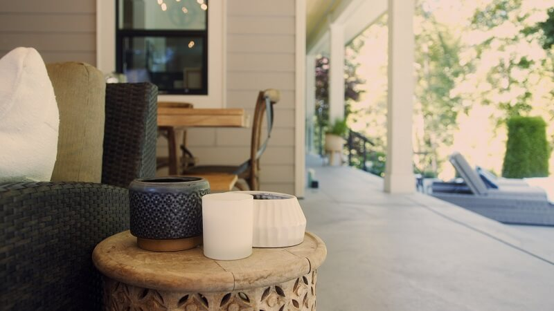 mosquito-repellent candles on a house porch and table