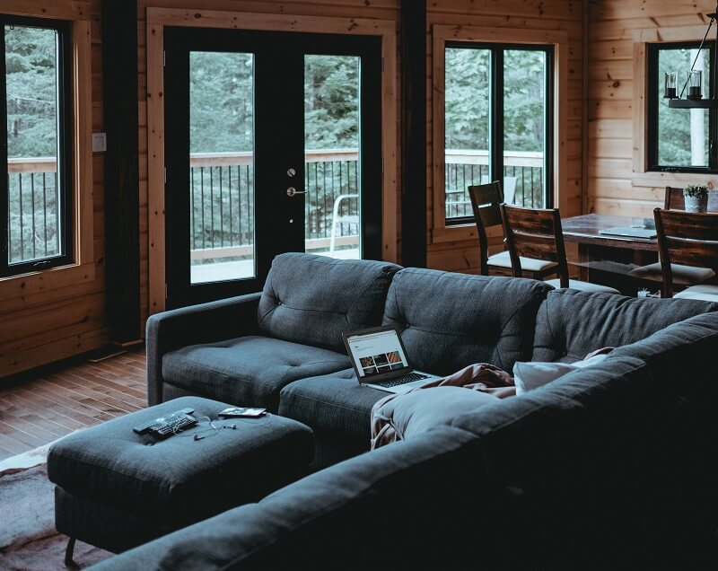 Cozy cabin with dark sectional couch