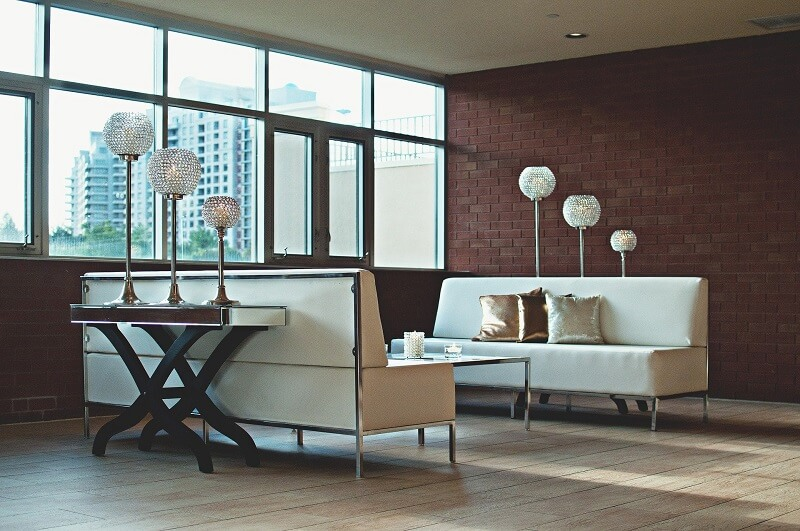Modern and open living room with two white couches
