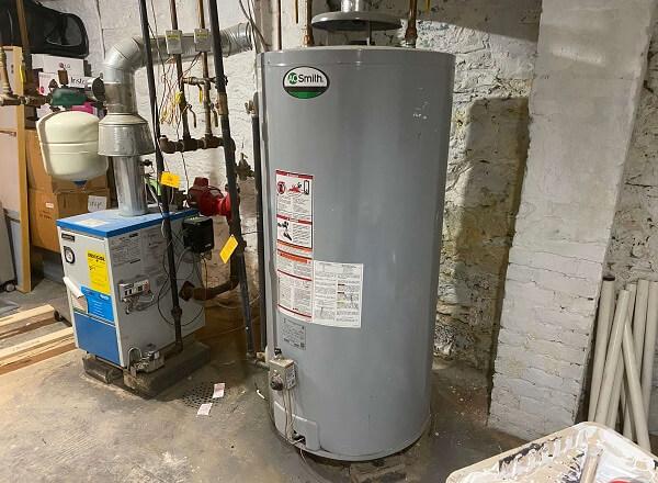 Hot water storage tank in a basement