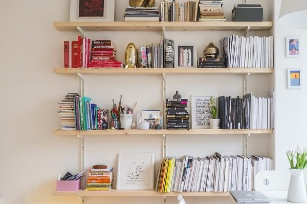 Bright and large bookshelf near a window