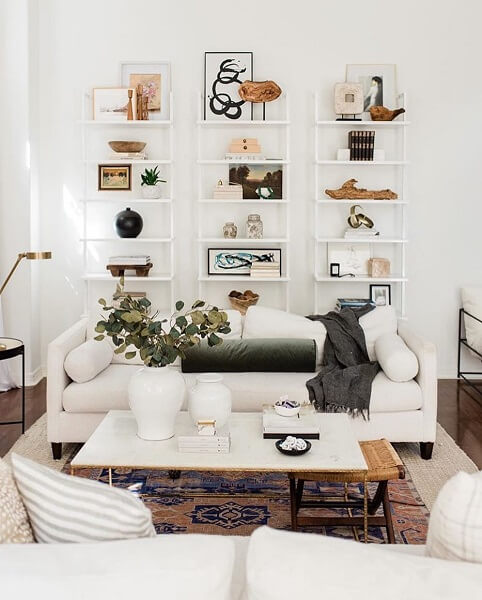 White and modern room with styled shelves