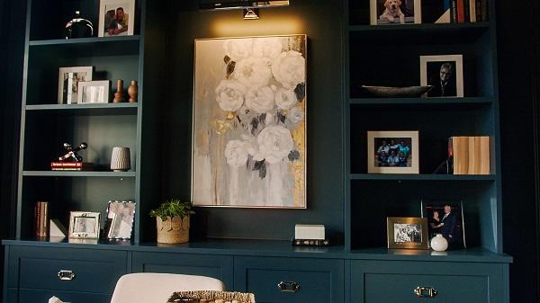 Large dark blue shelves with light decor