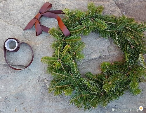 Classic evergreen branch with ribbon wreath