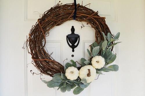 Farmhouse style wreath on a white door