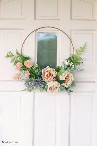 Simple flower wreath on a white door