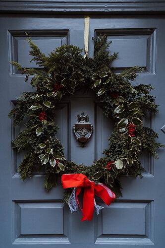 Large outdoor wreath on a blue door