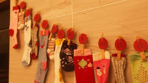 Socks advent calendar above fireplace