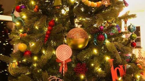 Large gold and red ornament in a Christmas tree