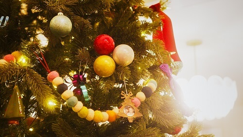 Group of colourful ornaments on a tree