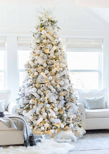 Large white Christmas tree in a living room