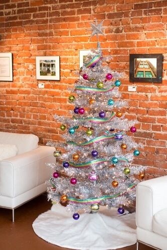 Artificial Christmas tree against a brick wall