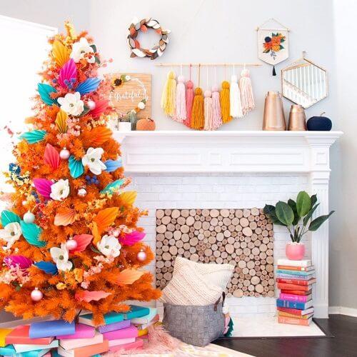 Orange Christmas tree in a white room