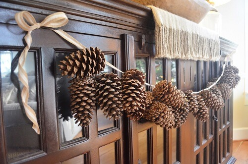 Homemade strung pinecone garland display