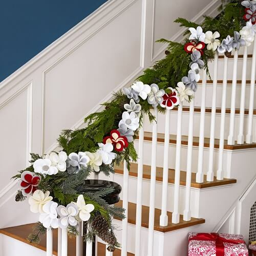 Large flower and evergreen garland on a railing