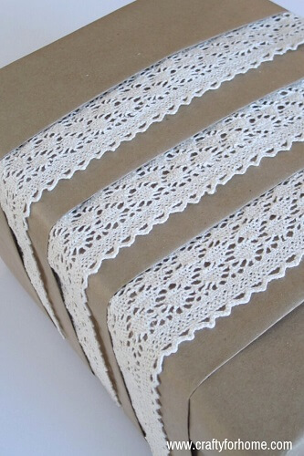 Gift wrapped in lace and brown paper