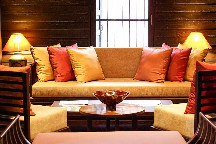 Colourful silk pillows on a couch in an upscale living room
