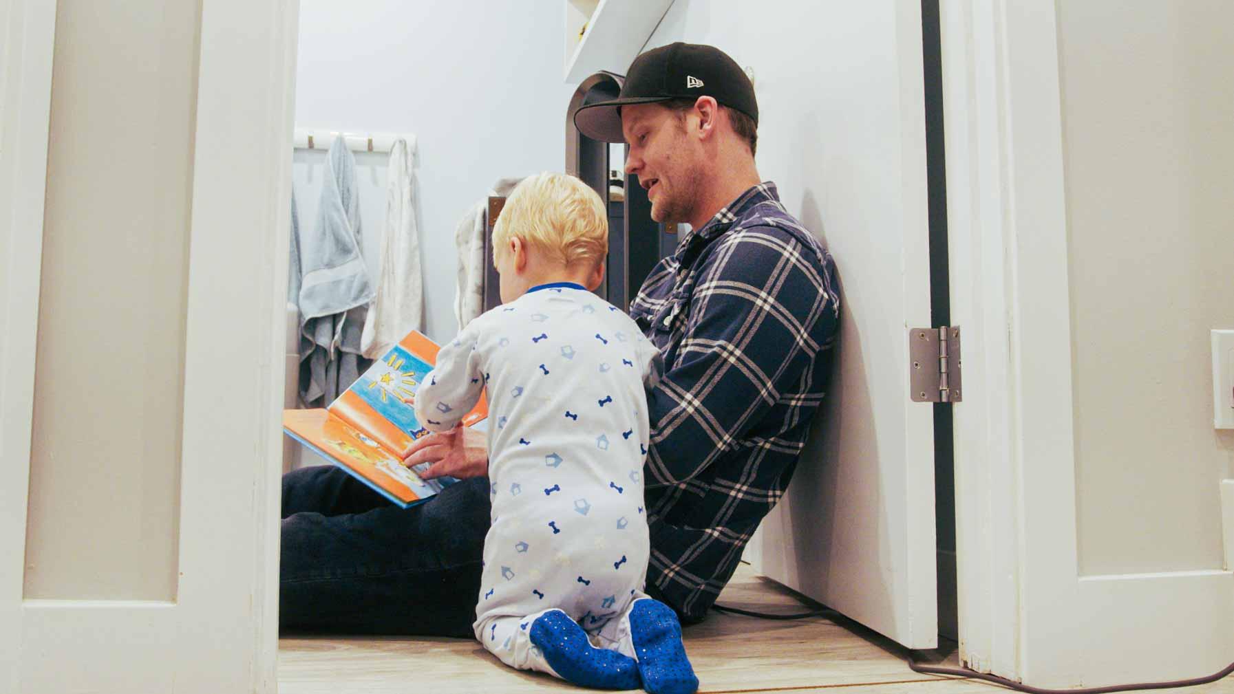 Matthew and Beckett reading a book