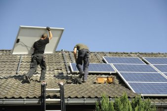 Solar panels and two workers