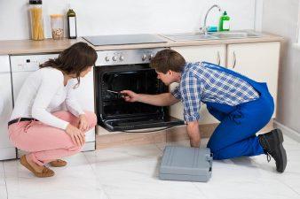 Technician checking an oven